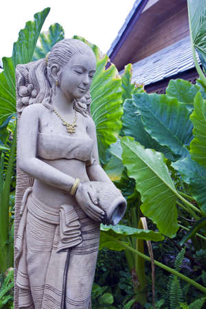 molded woman Thai figure is thatting decrease tree water , ( , the molded figure in public nobody park is owner of ) , Stock Photo - 7476787