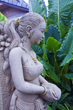 molded woman Thai figure in standing decreases tree water( , the molded figure in public nobody park is owner of ) ,  photo