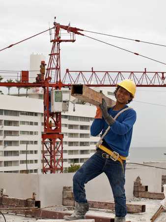 a man is whoing work to build on the building , at Huahin , Thailand ,  photo