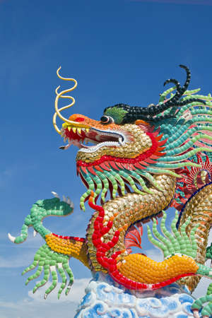 dragon vertical: many color dragons on blue sky ( , at take a photograph in the vertical ) , a city is Nakolsawun , Thailand ,  ( , a dragon that established in at the public park with the taxation of people , nobody is owner of ) ,