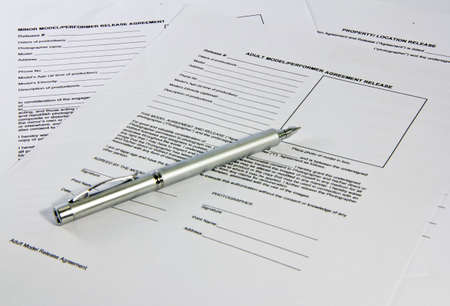legal documents: Pen saving on legal documents, contracts shot with the depth of information