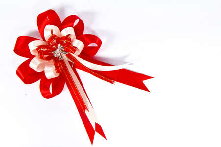red bow and white on colored white paper Stock Photo