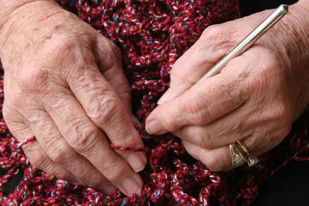 arthritic: Senior or grandmothers hands crocheting