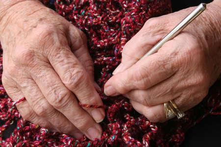 arthritic: Senior or grandmothers hands crocheting