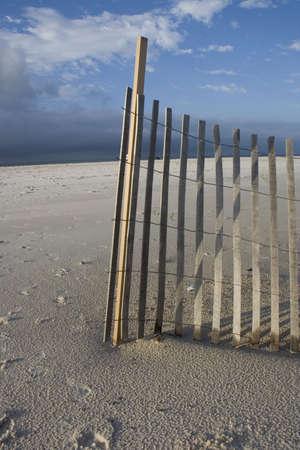 barrier: Sand barrier and sky on beach Stock Photo