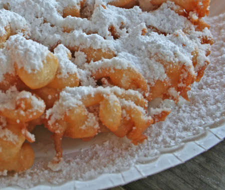Fresh funnel cake with powdered sugar topping