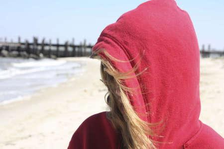 Hooded woman on beach