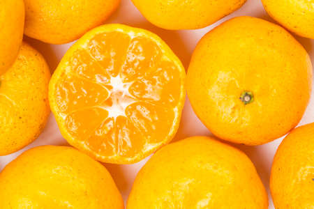 Many citrus fruit Lay heaped on a white background.