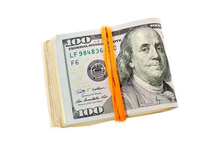 Folded stack of hundred dollars bills on white background  photo