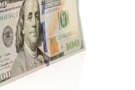 one hundred: Single hundred dollars bill standing at an angle  Done on white background  Stock Photo