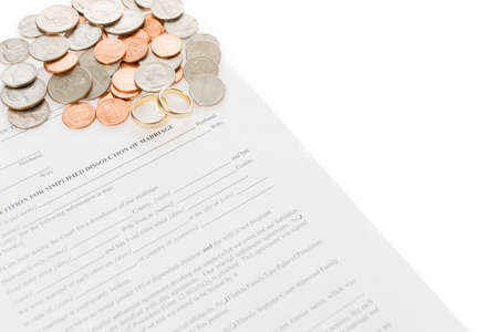 Divorce Form With Spread Pile Of Coins And Pair Of Wedding Rings photo