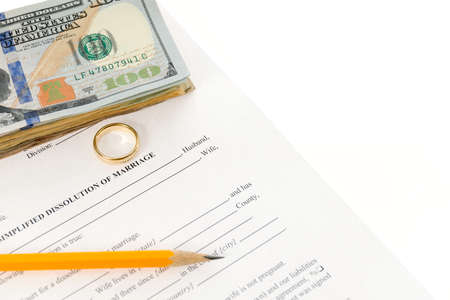 Divorce Form With Stack of Hundred Dollars Bills, Single Wedding Ring, Pencil photo