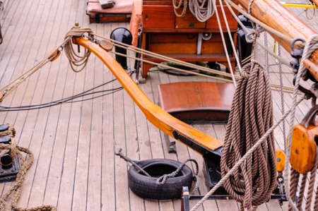View on upper deck of sailing ship with tiller at daylight. Stock Photo