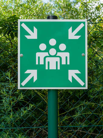 Sign with pictogram symbolizing an assembly station for people in case of an emergency or catastrophe.