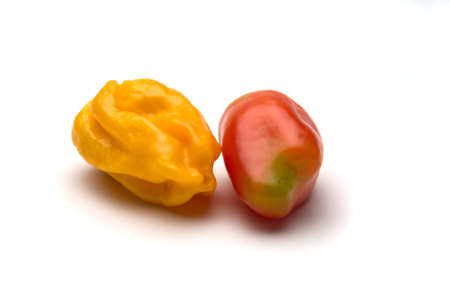 One yellow ripe  pepper and one  red ripe pepper isolated on white background. Selective focus. Stock Photo