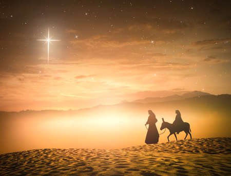 Silhouette pregnant Mary and Joseph with a donkey on star of cross background Stock Photo