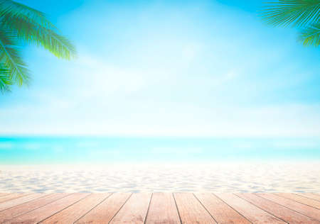 Summer holiday concept: Wooden table with coconut palm tree at the beach background