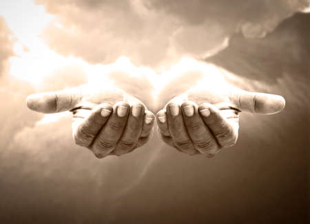Good friday concept: Jesus Christ open empty hands with palm up on heaven background 免版税图像