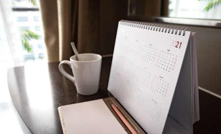 Calendar 2021 on wooden desk