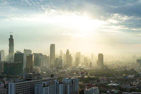 City and sky sunrise background. Bangkok, Thailand, Asia 免版税图像