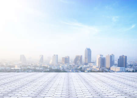 World environment day concept: Stone terrace at rooftop with abstract blur city and blue sky and clouds background. Bangkok, Thailand, Asia