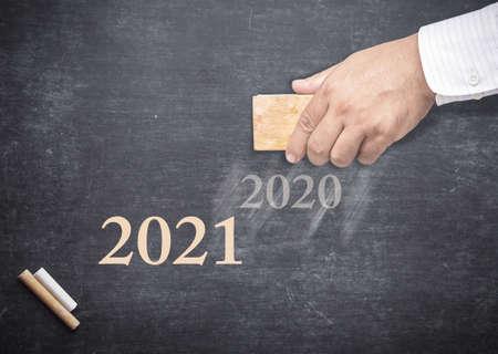 Businessman hand holding eraser for change word