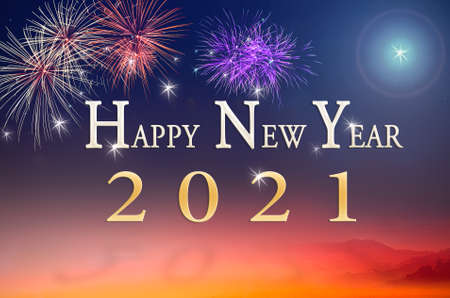 Text for Happy New Year 2021 over fireworks on night background 免版税图像
