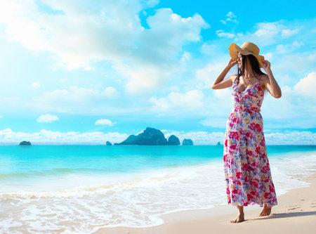 Happy traveler woman enjoys her tropical beach vacation Stock Photo