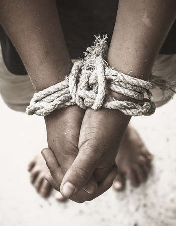 International human rights day concept: Human hands was tied with a rope