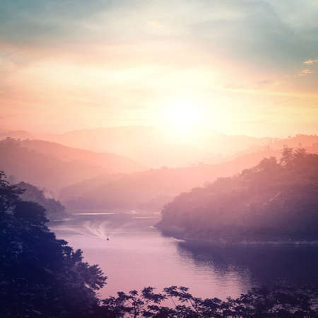 World environment day concept: Mountain river landscape at sunset background. Bang Lang Reservoir at Bethong, Yala, Thailand, Asia