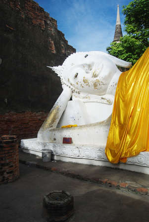 Reclining Buddha white statue face at Wat Yai Chai Mong kol Ayutthaya Thailand photo