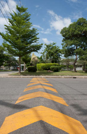 yellow direction lines on asphalt with blue sky Stock Photo - 13993579