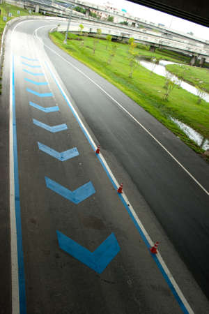 blue direction on highway ahead photo