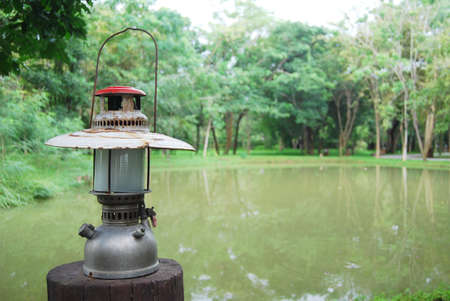 The old Paraffin lamp in forest Stock Photo - 14028940