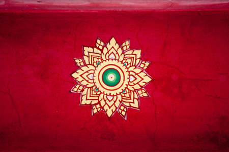close up Beautiful red ancient thai style pattern in Thai temple photo