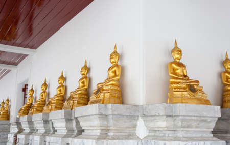 Row of golden images of Buddha  photo