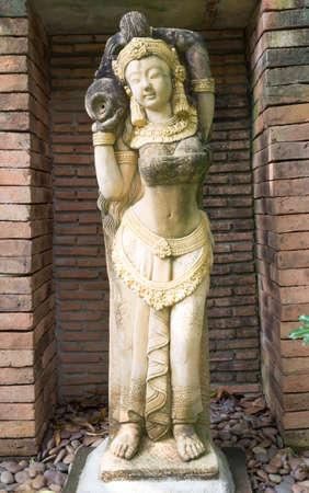 ancient woman hold a jar  sculpture  photo