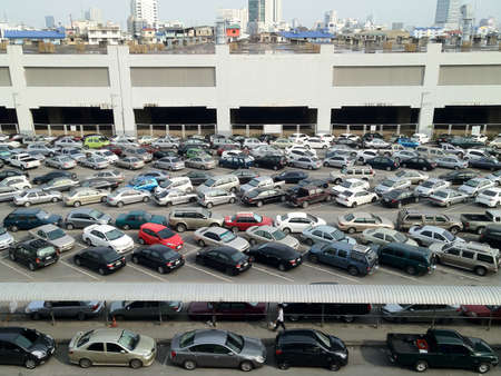 new car lot: Lots of cars parked in parking lot outdoor in the city  Stock Photo