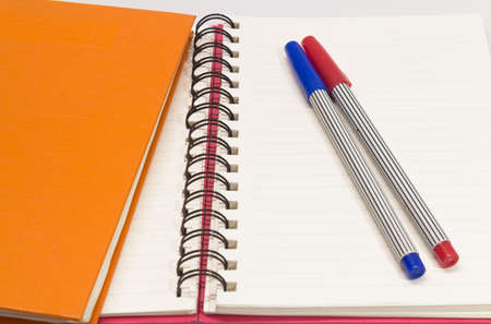 Close-up of pink orange note book and pen Stock Photo - 18262485