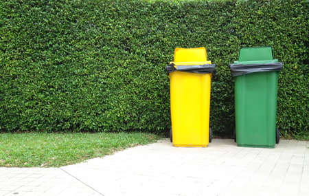 waste disposal: Different Colored Bins Green and yellow waste container Stock Photo