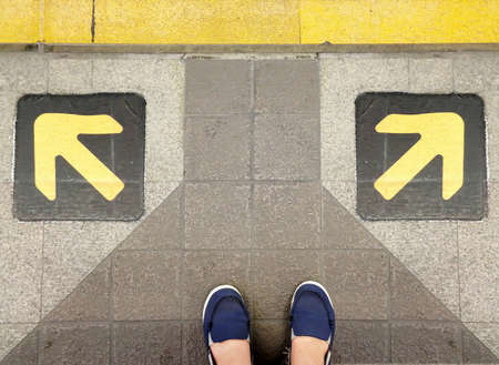 Man standing behind choice way to decision path photo