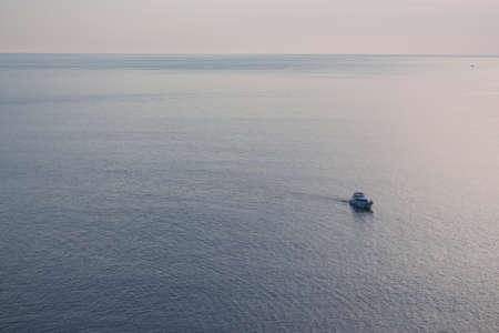 speedboat: loneliness speedboat in sea, sepia tone
