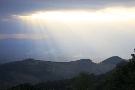 clearly: clearly horizon sunlight from cloud rays to green hill Stock Photo