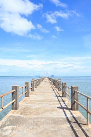 jetty: old wooden bridge to dock pier in tranquil sea dream destination ,Trang Thailand