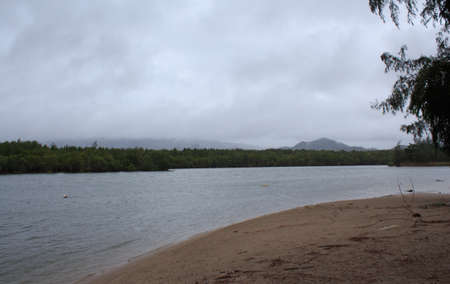 beach rain: mist and fog after rain at sea beach and clouds