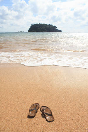 swim shoes: flip flops sandals on sand beach in relax and vacation summer time Stock Photo