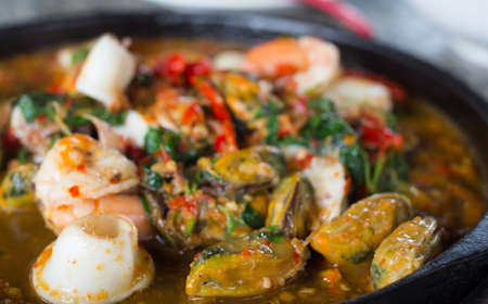 sizzling: Sizzling spicy fried seafood Stock Photo