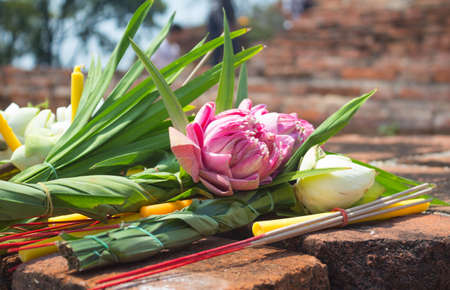 incense candle and pink lotus for pray on ancient brick wall temple 版權商用圖片