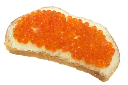 Sandwich of white bread with butter and red caviar isolated on a white background photo