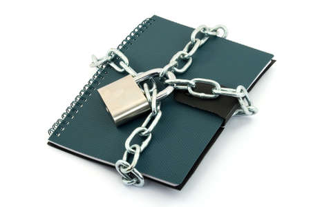 book locked with padlock and chains photo